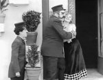 Edna-Purviance-and-Eric-Campbell-and-Charlie-Chaplin-in-The-Fireman-1916-10.jpg