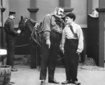 Eric-Campbell-and-Charlie-Chaplin-in-The-Fireman-1916-2.jpg