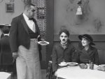 Eric-Campbell-and-Charlie-Chaplin-and-Edna-Purviance-in-The-Immigrant-1917-10.jpg