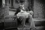 Charlie-Chaplin-in-The-Kid-1921-08.jpg