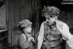 Jackie-Coogan-and-Charlie-Chaplin-in-The-Kid-1921-16.jpg