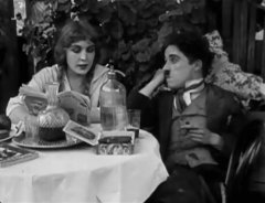 Edna-Purviance-and-Charlie-Chaplin-in-The-Tramp-1915-12.jpg