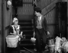 Edna-Purviance-and-Charlie-Chaplin-in-Work-1915-07.jpg
