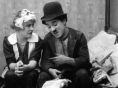 Edna-Purviance-and-Charlie-Chaplin-in-Work-1915-12a.jpg