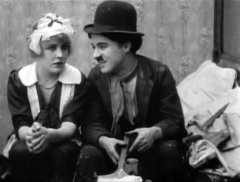 Edna-Purviance-and-Charlie-Chaplin-in-Work-1915-12c.jpg