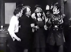 Nick-Cogley-and-Mabel-Normand-and-Ford-Sterling-in-Hide-and-Seek-1913-08.jpg