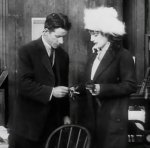 Helen-Holmes-in-The-Escape-on-the-Fast-Freight-1915-8.jpg