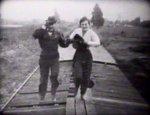 Helen-Holmes-and-Leo-Maloney-in-The-Leap-from-the-Water-Tower-1915-9.jpg