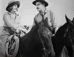 Frank-Rice-and-Evelyn-Nelson-in-The-Desert-Rider-1923-09.jpg