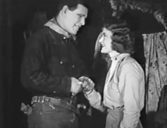 Jack-Hoxie-and-Evelyn-Nelson-in-The-Desert-Rider-1923-07.jpg