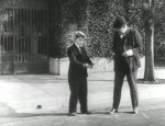 Buster-Keaton-and-Joe-Roberts-in-Cops-1922-2.jpg