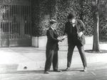 Buster-Keaton-and-Joe-Roberts-in-Cops-1922-3.jpg