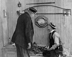Joe-Roberts-and-Buster-Keaton-in-The-Love-Nest-1922-05.jpg