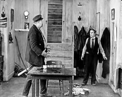 Joe-Roberts-and-Buster-Keaton-in-The-Love-Nest-1922-06.jpg