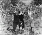Joe-Roberts-and-Buster-Keaton-and-Sybil-Seely-in-The-Scarecrow-1920-22.jpg