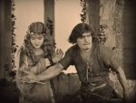 Douglas-Fairbanks-and-Enid-Bennett-in-Robin-Hood-1922-23.jpg