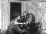 Buster-Keaton-and-Ernest-Torrence-in-Steamboat-Bill-Jr-1928-39.jpg