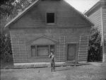 Buster-Keaton-and-wall-in-Steamboat-Bill-Jr-1928-002.jpg