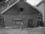 Buster-Keaton-and-wall-in-Steamboat-Bill-Jr-1928-003.jpg