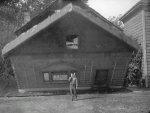 Buster-Keaton-and-wall-in-Steamboat-Bill-Jr-1928-004.jpg