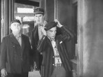 Tom-Lewis-and-Ernest-Torrence-and-Buster-Keaton-in-Steamboat-Bill-Jr-1928-08.jpg