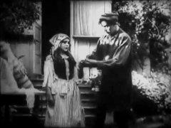 Arthur-V-Johnson-and-Mary-Pickford-in-Love-among-the-Roses-1909.jpg