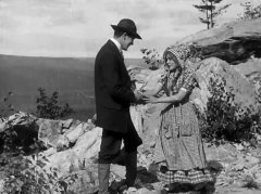 Arthur-V-Johnson-and-Mary-Pickford-in-The-Mountaineers-Honor-1909.jpg