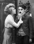 Edna-Purviance-and-Charlie-Chaplin-in-The-Pawnshop-1916-00.jpg