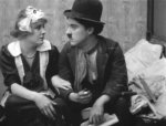 Edna-Purviance-and-Charlie-Chaplin-in-Work-1915-001.jpg