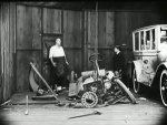 Joe-Roberts-and-Buster-Keaton-in-The-Blacksmith-1922-001.jpg