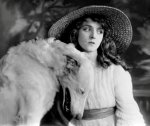 Olive-Thomas-with-white-dog.jpg