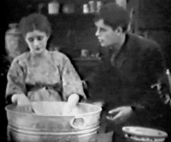 Mae-Marsh-and-Robert-Harron-in-His-Mothers-Son-1913a.jpg